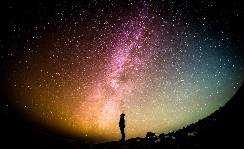 Man Looking at Colorful Milky Way