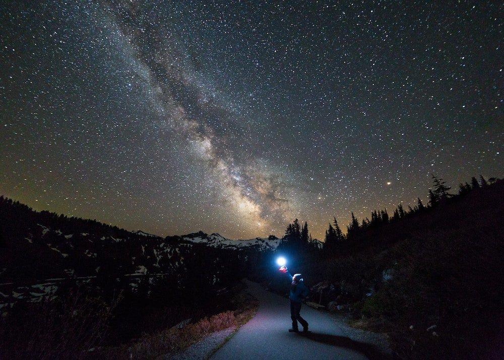 Mount Rainer Stargazing - Person Standing in Mount Rainier National Park under Milky Way