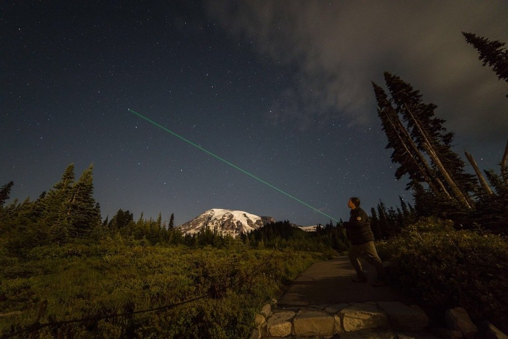 Mount Rainier Stargazing - Park Ranger and Green Laser Pointing to Stars with Mount Rainier in the Background