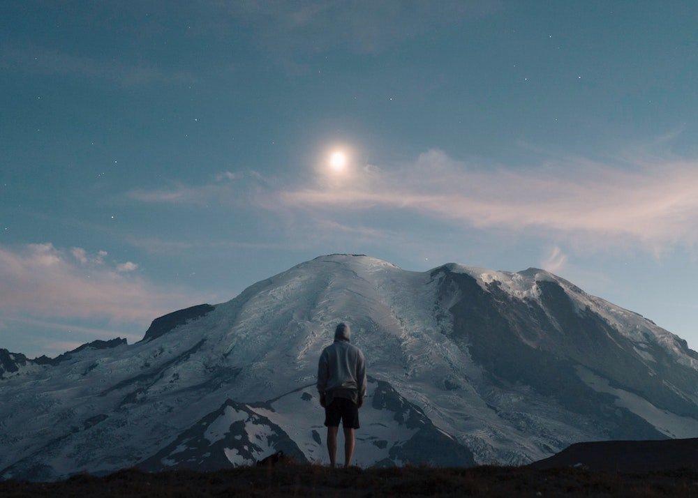 Mount Rainier Stargazing - Man Standing facing Moon and Mount Rainier